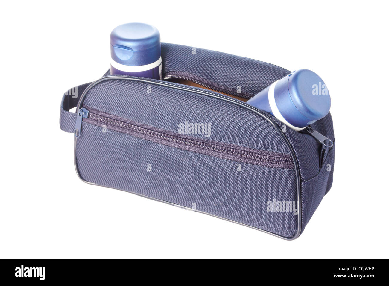 Open blue travel toiletries bag with man`s cosmetics isolated against a white background - Stock Image