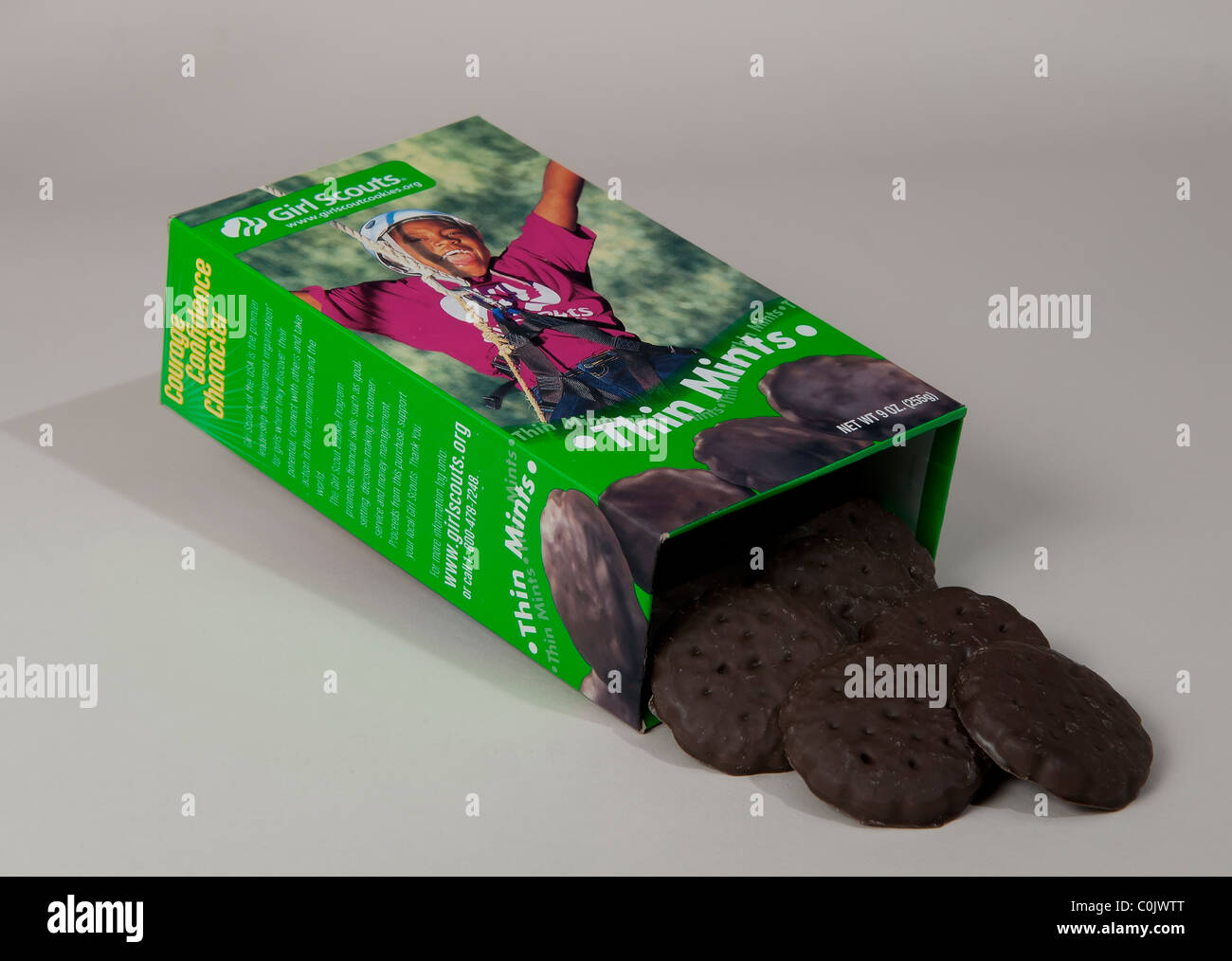 Cookies that spilled out of a box of girl scout cookies - Stock Image