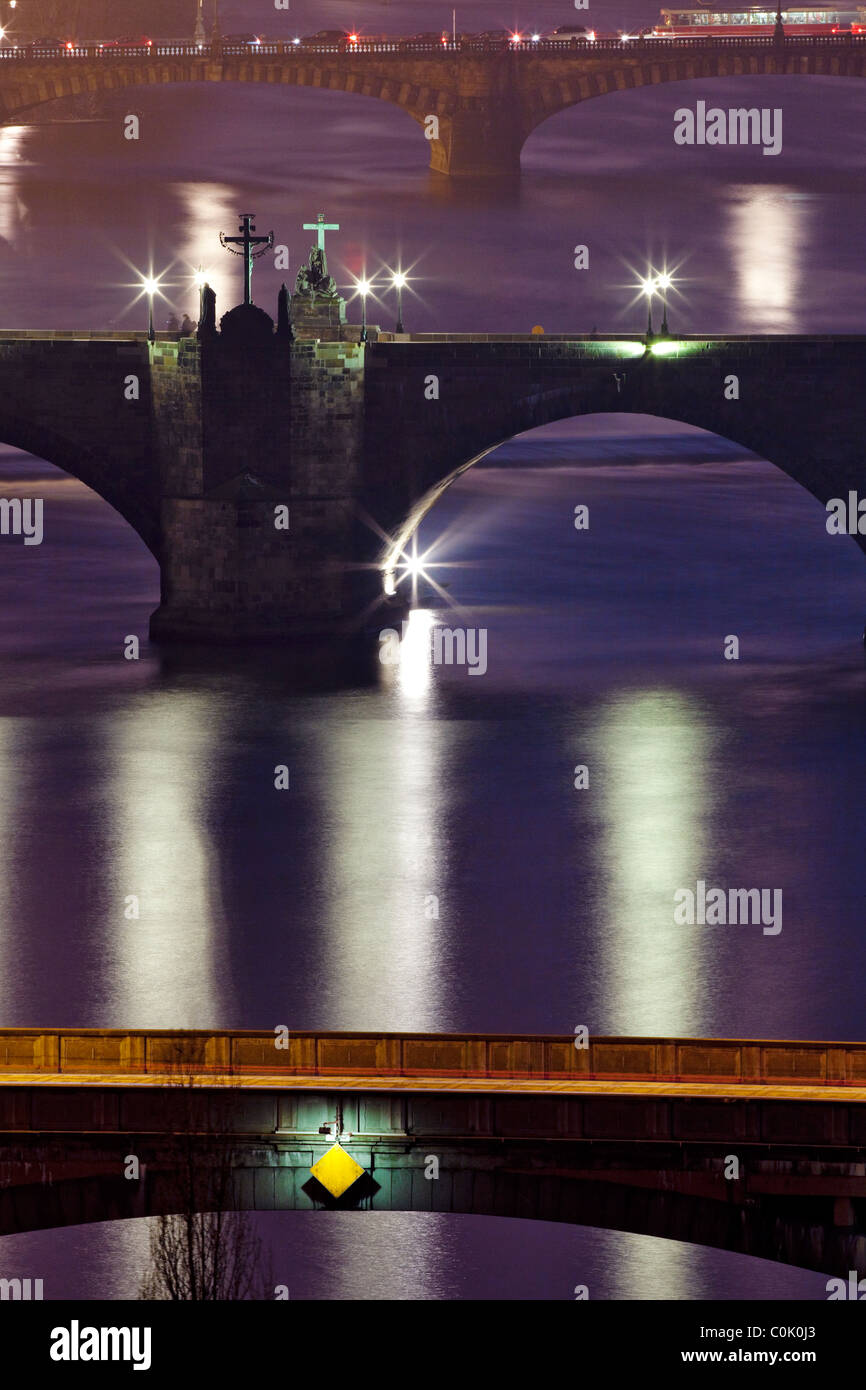 prague - bridges over vltava river at dusk - charles bridge in focus - Stock Image