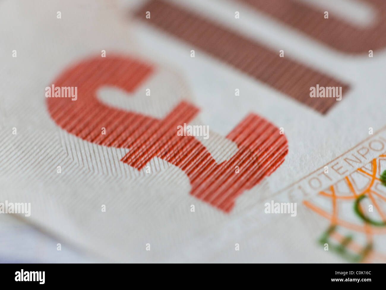 Ten pound sterling notes are set up for a photograph - Stock Image
