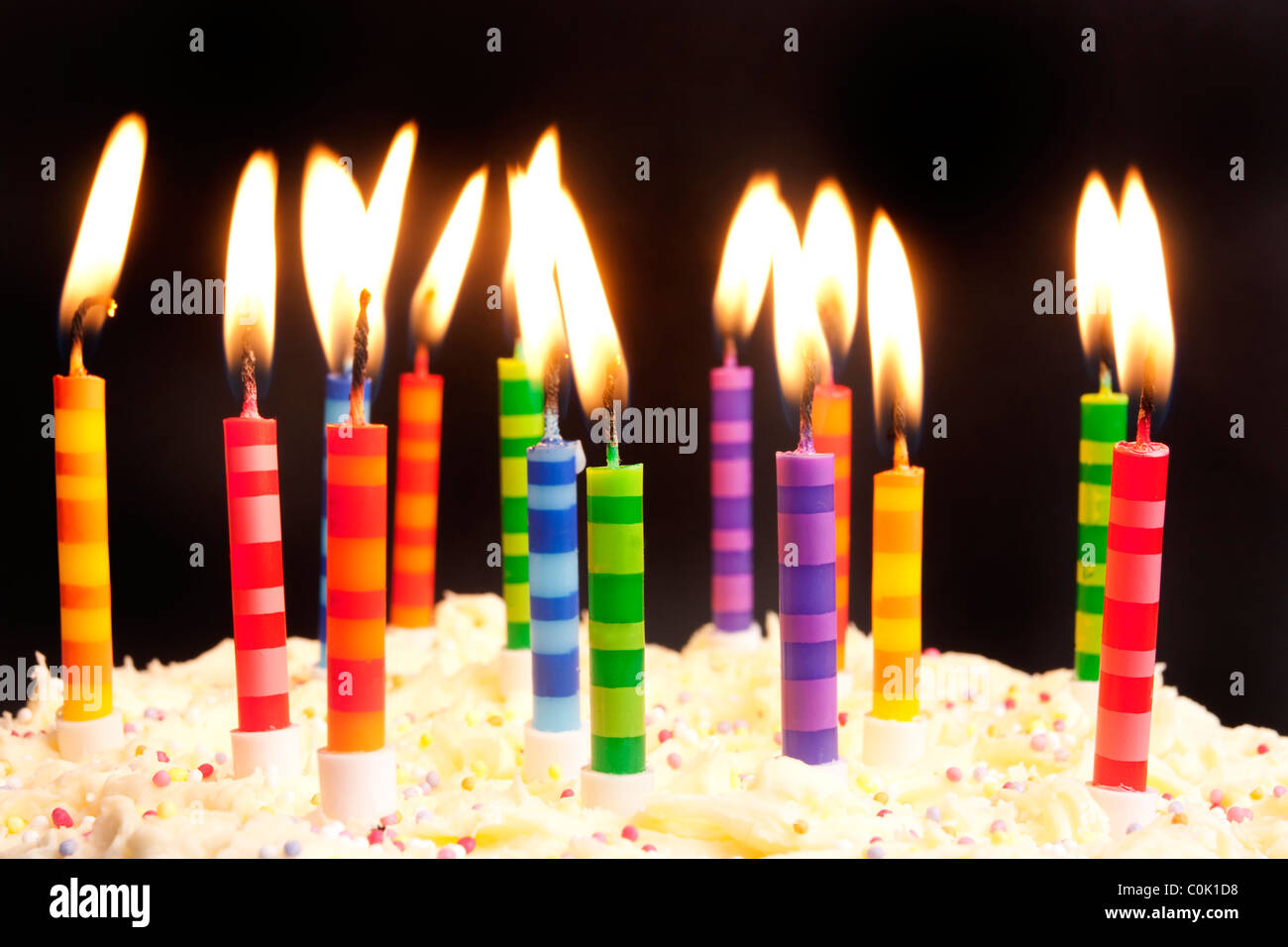 Birthday Cake Shot Images ~ Happy birthday cake shot on a black background with candles stock