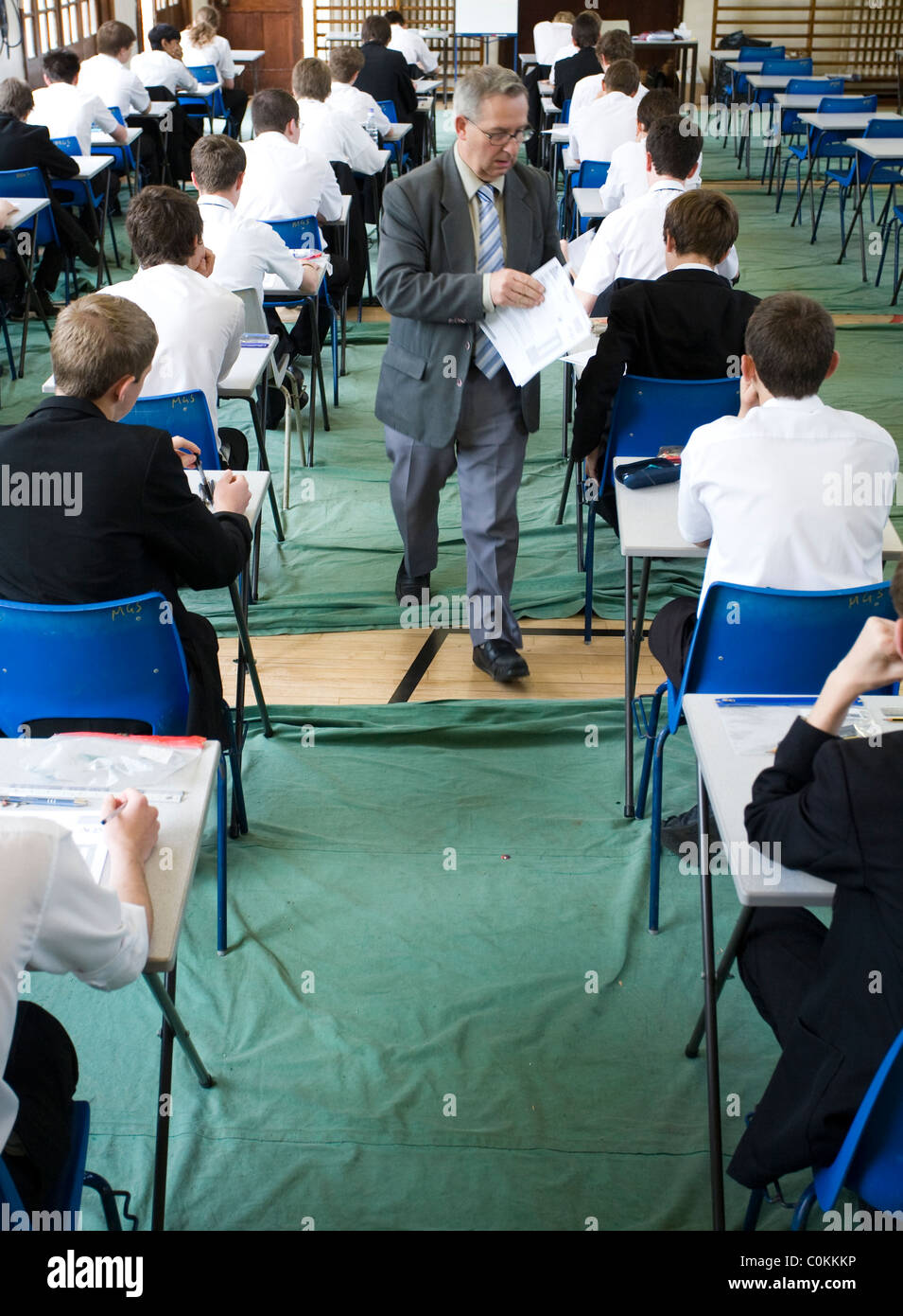 Pupils fill an exam hall to take a GCSE exam at Maidstone Grammar school in Maidstone, Kent, U.K. - Stock Image