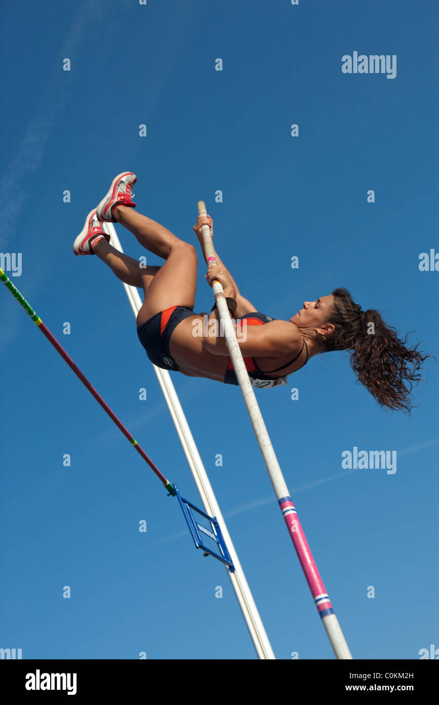 pole vault woman Sport outdoor Athletics competition race woman athlete jumping. Championships Spain, July 3rd 4th - Stock Image