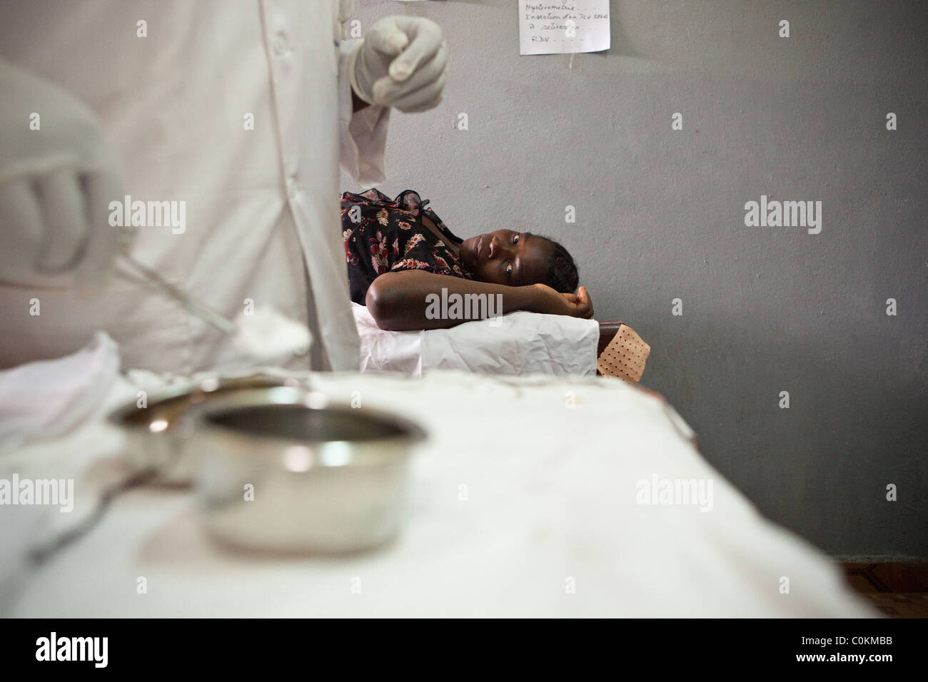 A woman receives a hormonal implant (jadelle) at a reproductive health clinic in Yaounde, Cameroon, West Africa. - Stock Image