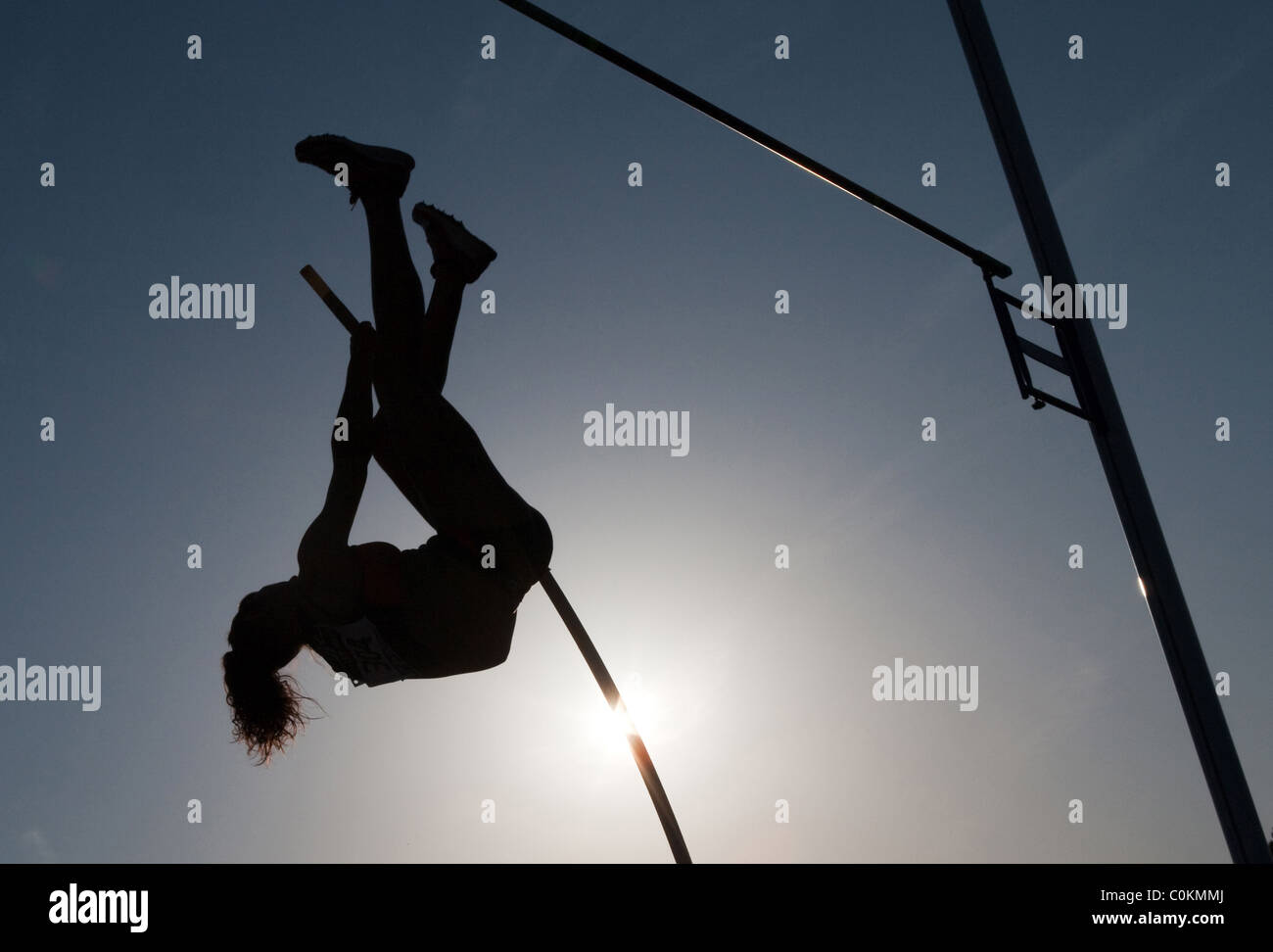 pole vaulting Sport outdoor Athletics competition race woman athlete. Championships of Spain, July 3rd 4th 2010 - Stock Image