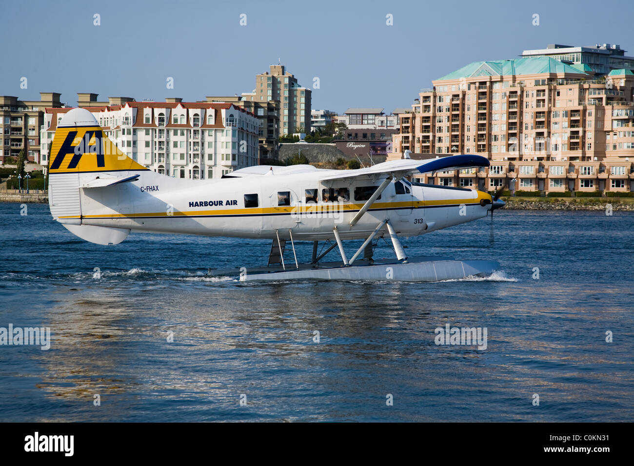 A turbo engined Beaver float plane taxiing in Victoria's harbour Stock Photo