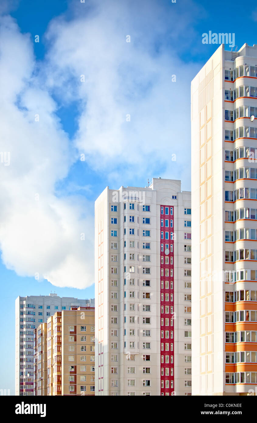 New apartment buildings on sky background. - Stock Image