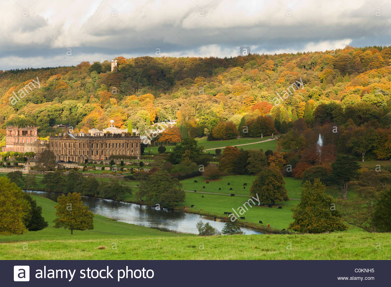 A view of Chatsworth House and Hunting Tower from across the River Derwent - Stock Image