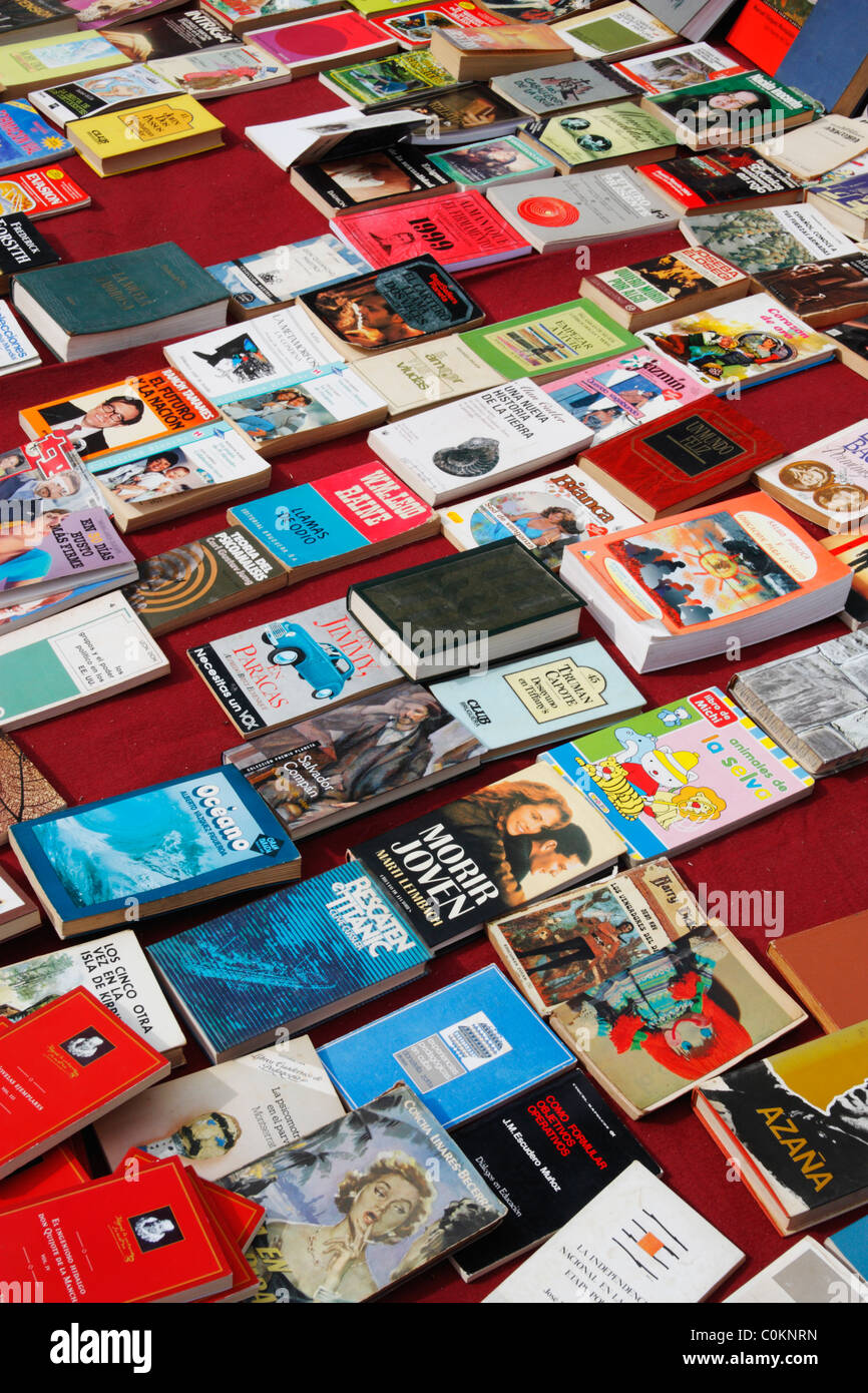 Secondhand books on market stall in Spain - Stock Image