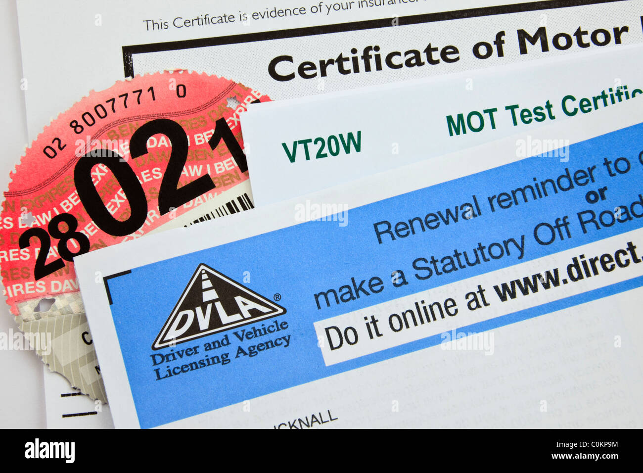 UK, Britain. DVLA renewal reminder form for renewing road tax disc with motor insurance certificate and MOT test - Stock Image