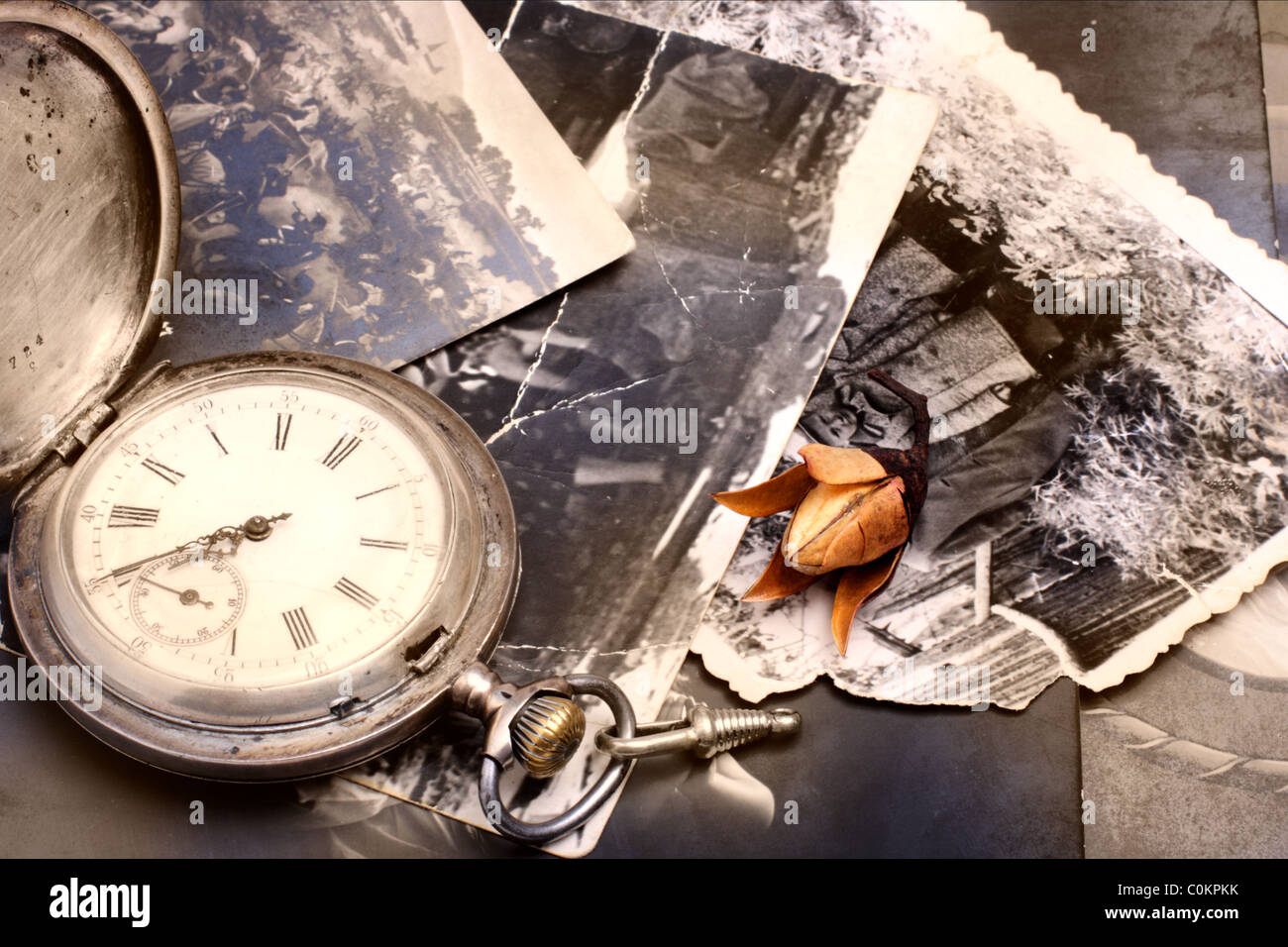 Old pocket watch on the old photos - Stock Image