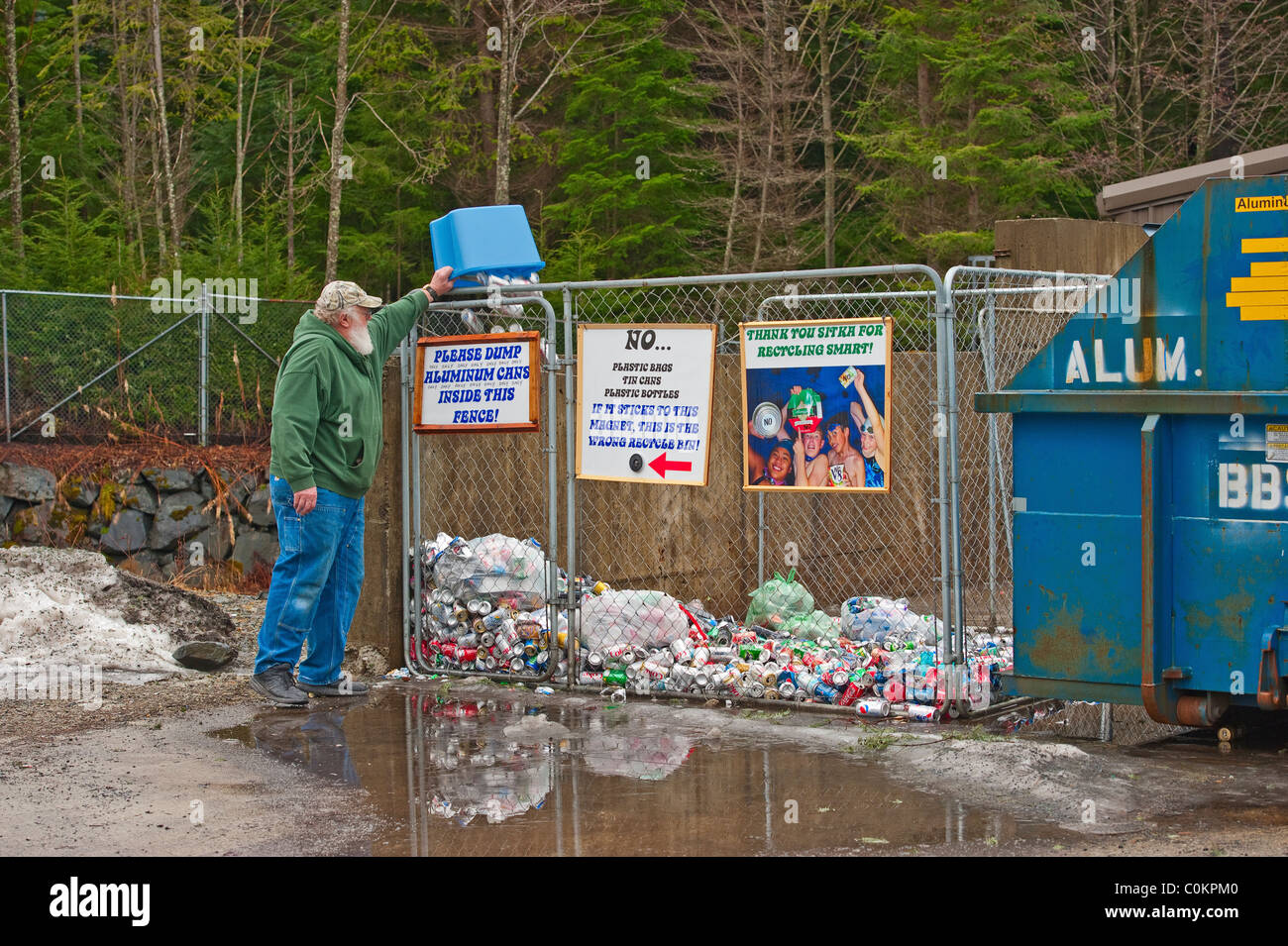 Sitka Community Schools, 'Re-cycle Sitka' collection center in Sitka, Alaska.  Alaskan man dumping aluminum - Stock Image
