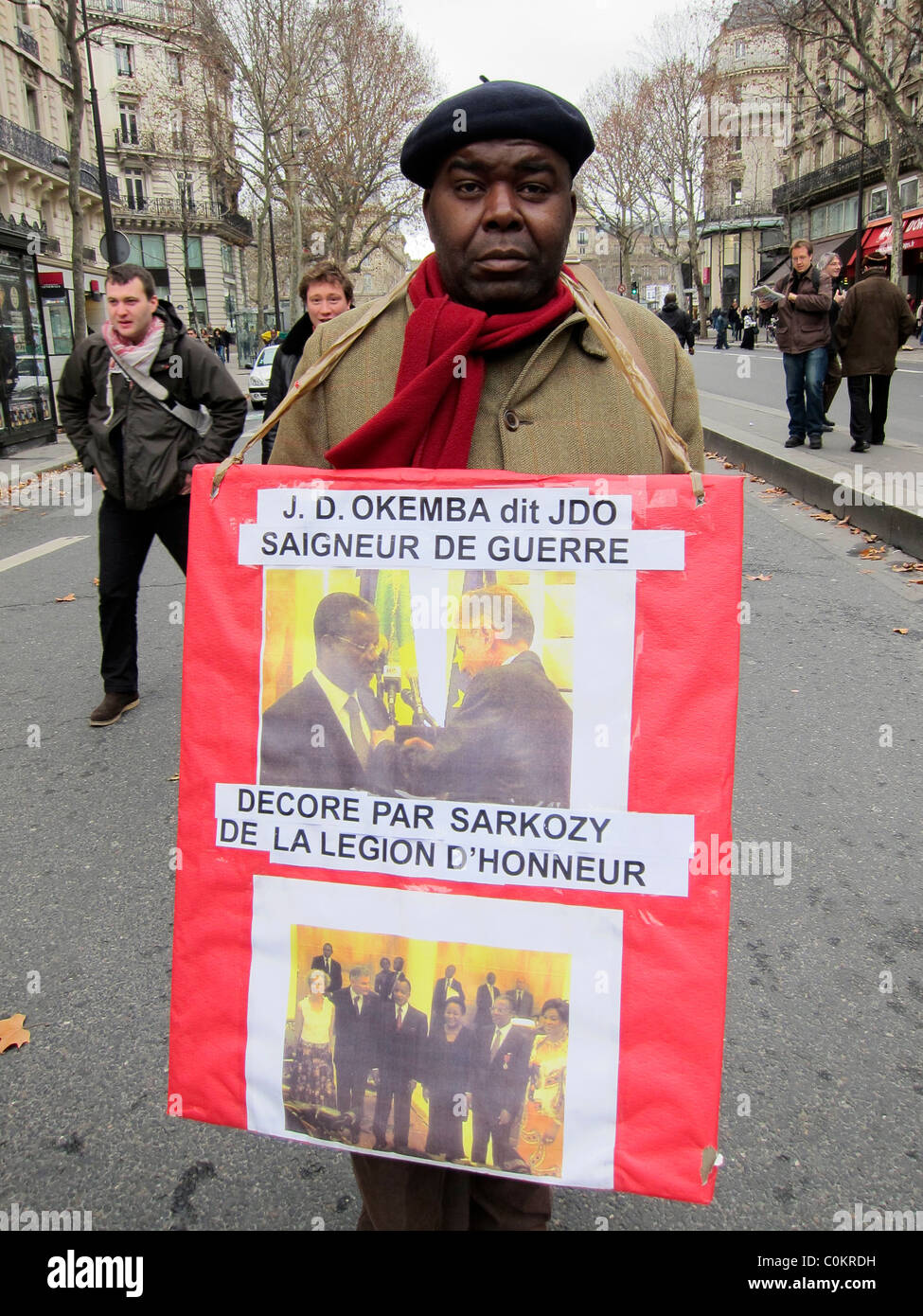 Paris, France, Congo Demonstration, Man Holding Sign in Opposition to the Congo-Brazzaville, Government - Stock Image