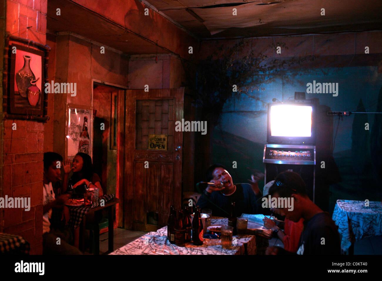 Patrons sing in a karaoke bar in Adriatico Street, Malate