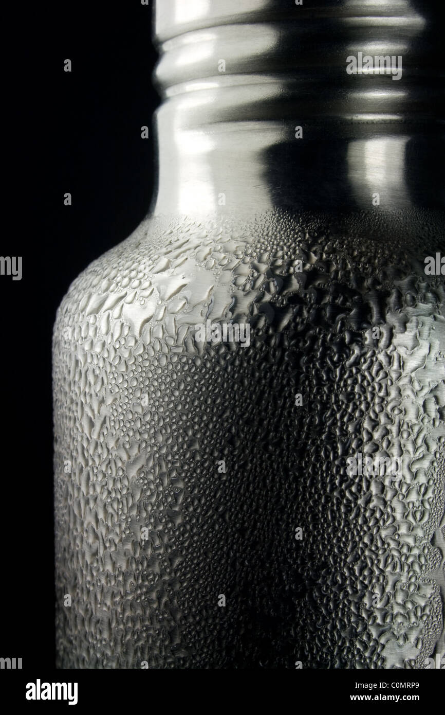 Water Condensation Drops on Cold Water Bottle - Stock Image