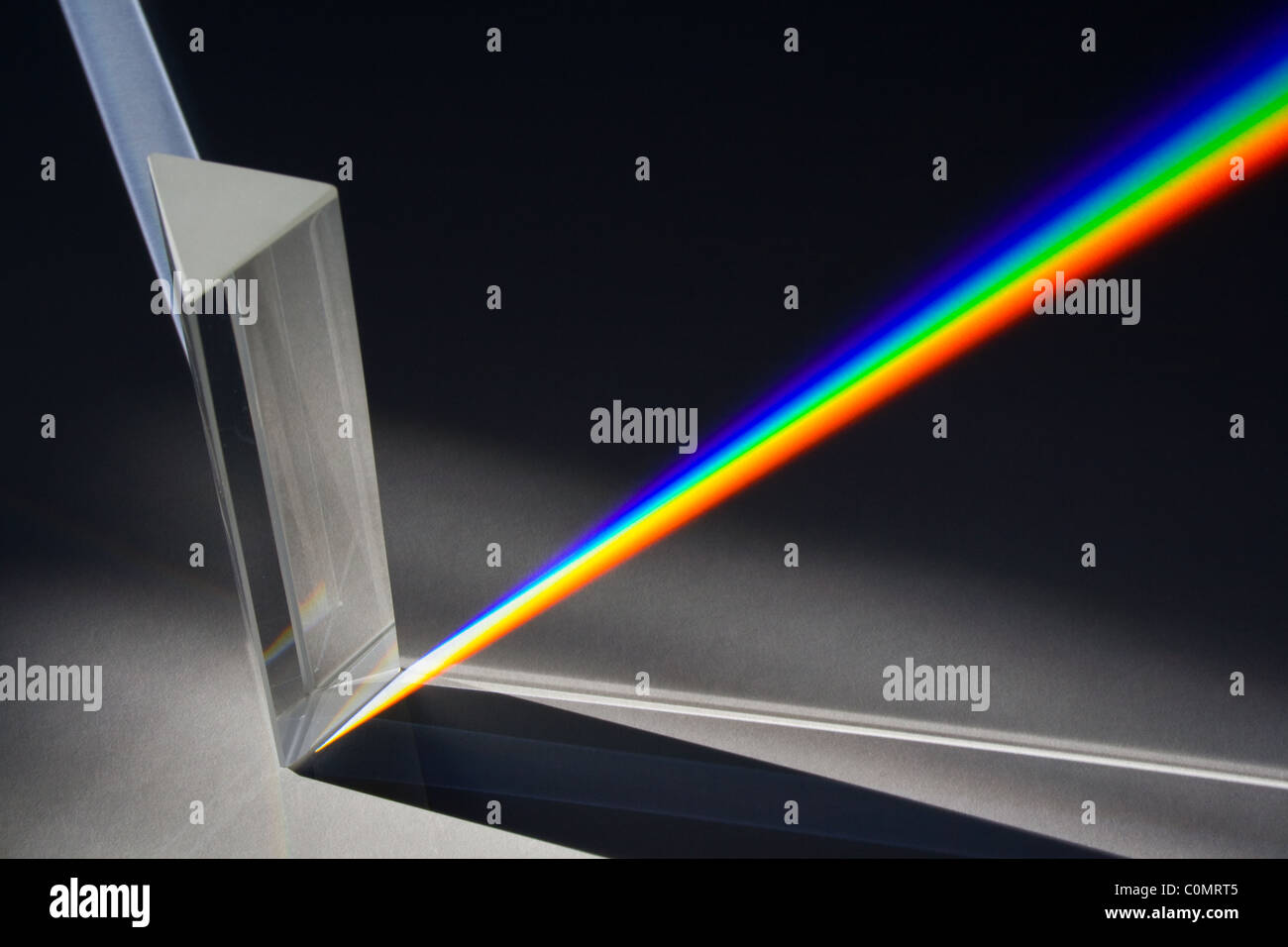 Light Spectrum Created by Sunlight Passing Through Glass Prism Stock Photo