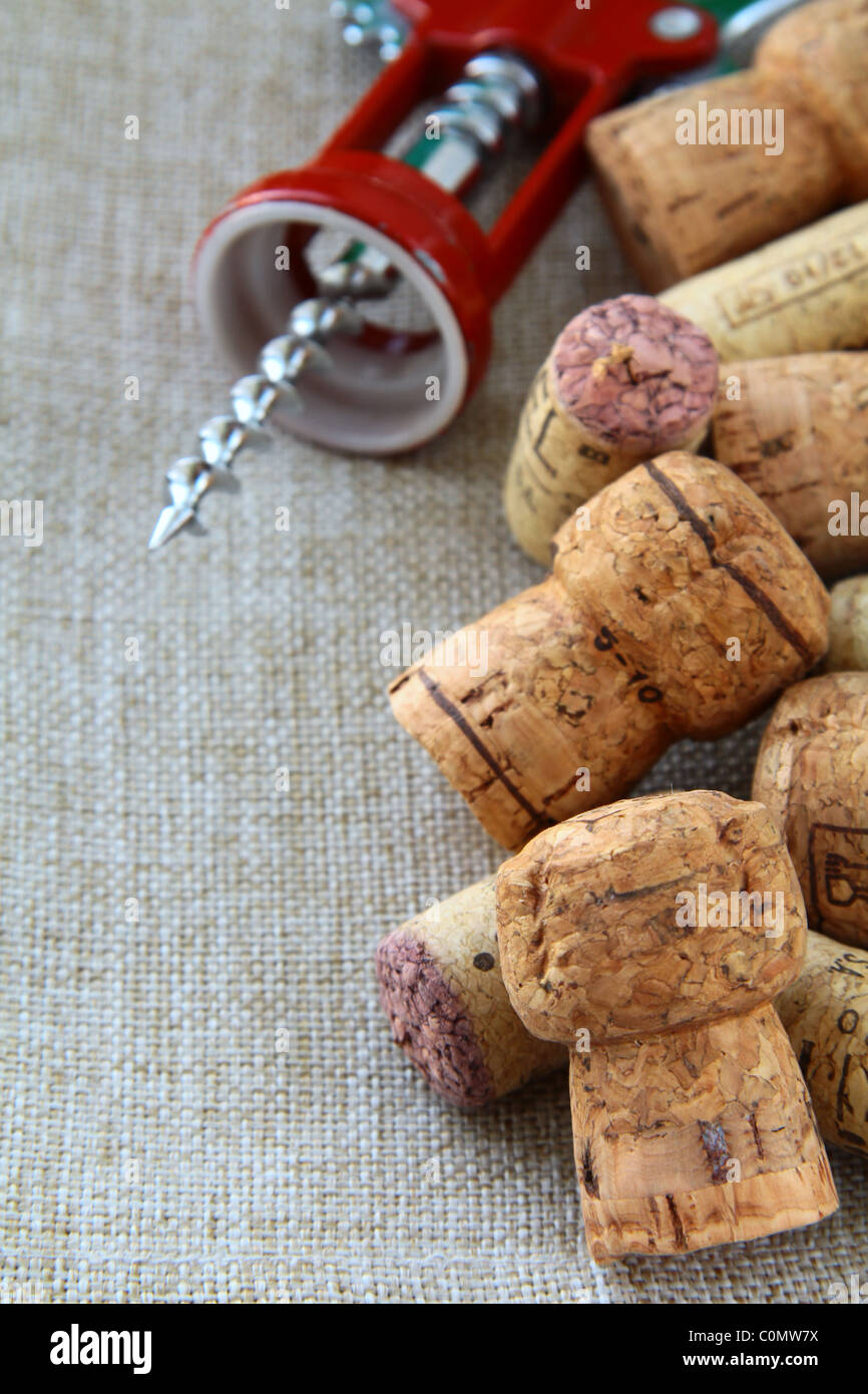 Corkscrews and corks on the natural background - Stock Image
