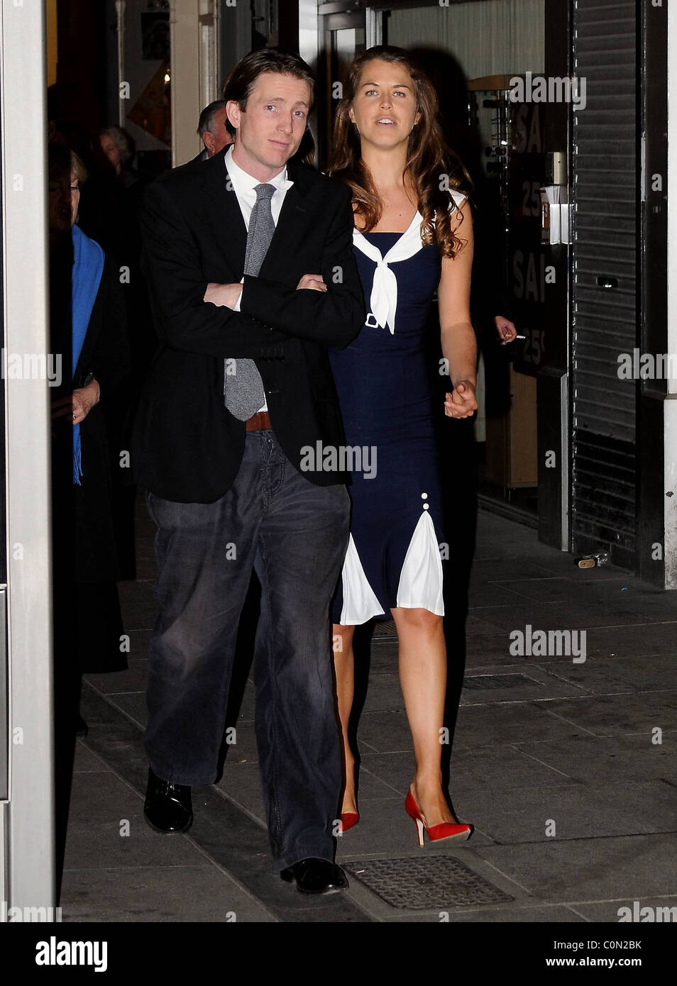 Trevor White and mystery woman leaving Vanessa Redgrave's performance of 'The Year of Magical Thinking' - Stock Image