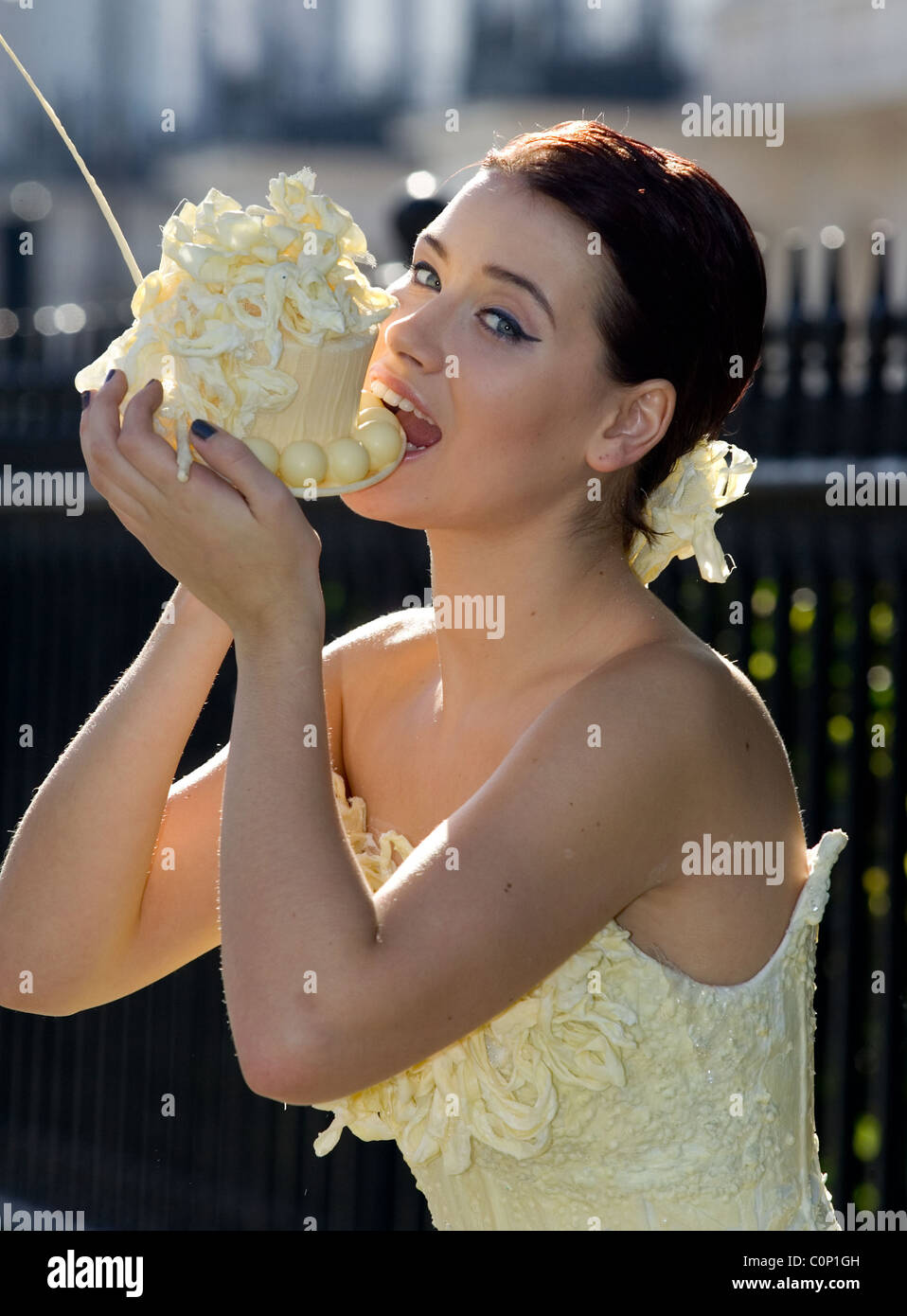 THE BRIDE WORE WHITE...CHOCOLATE! This outfit looks good enough to eat... Bridalwear designer Ian Stuart has come Stock Photo