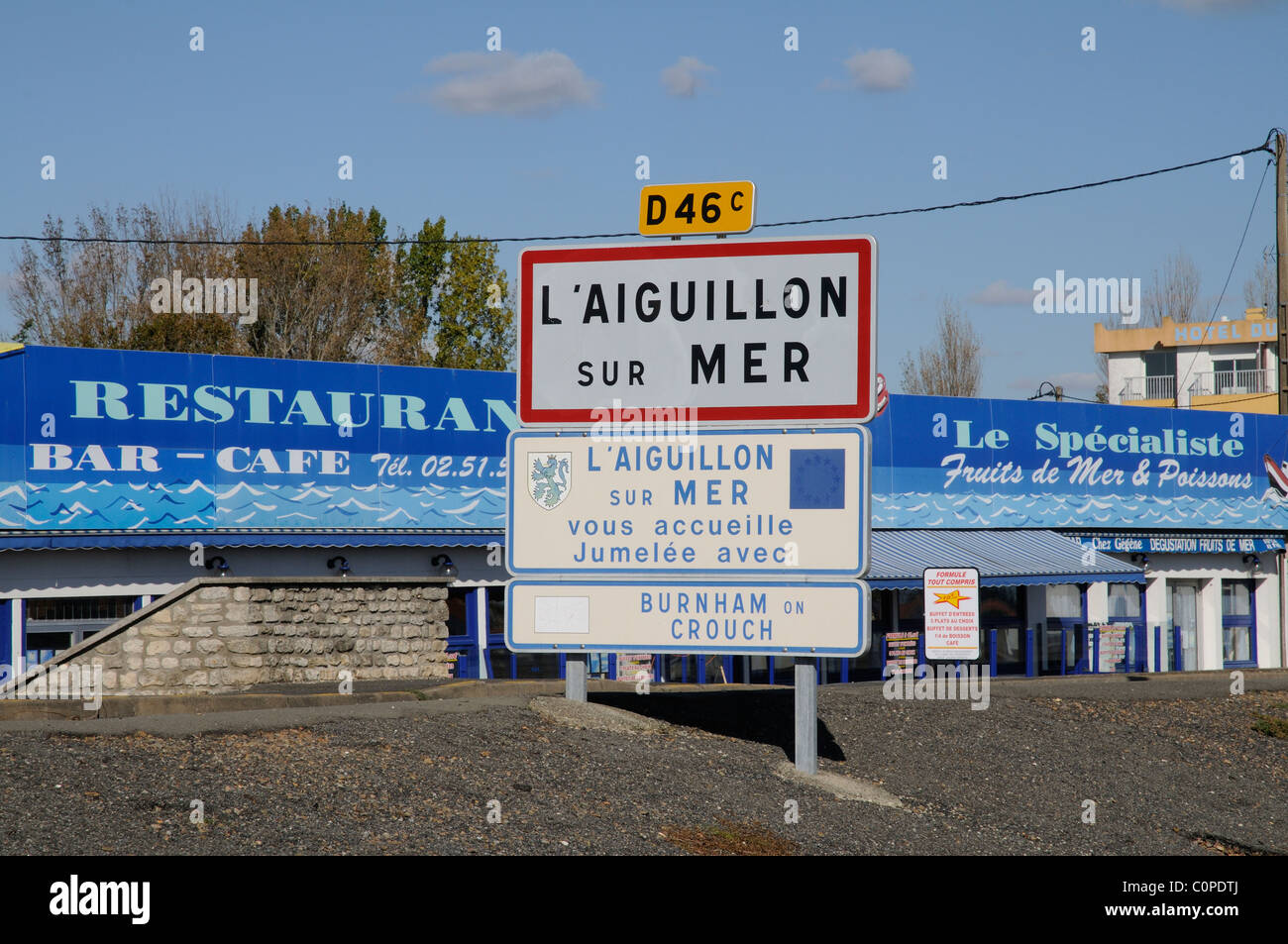 The port at L'Aiguillon sur Mer in the Vendee region of western France EU Road sign and town twinning signs - Stock Image