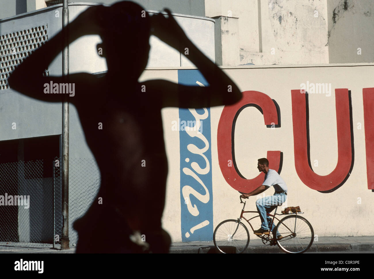Havana Cuba Young boy poses against background of Viva Cuba Libre painting in old Havana - Stock Image