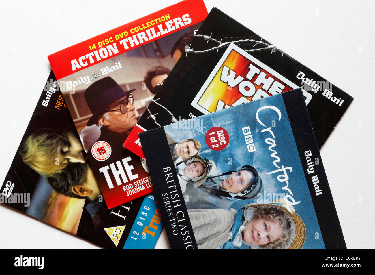 Selection of free DVDS given away with the Daily Mail set on white background - Stock Image