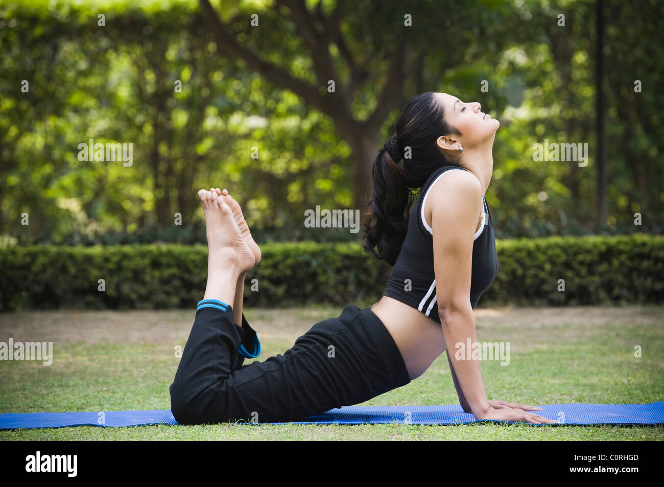 Woman Doing Ardha Bhujangasana Half Cobra Pose