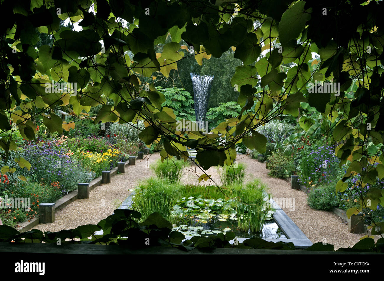 A view into the sunken garden with flowing water feature at East Ruston Old Vicarage garden - Stock Image