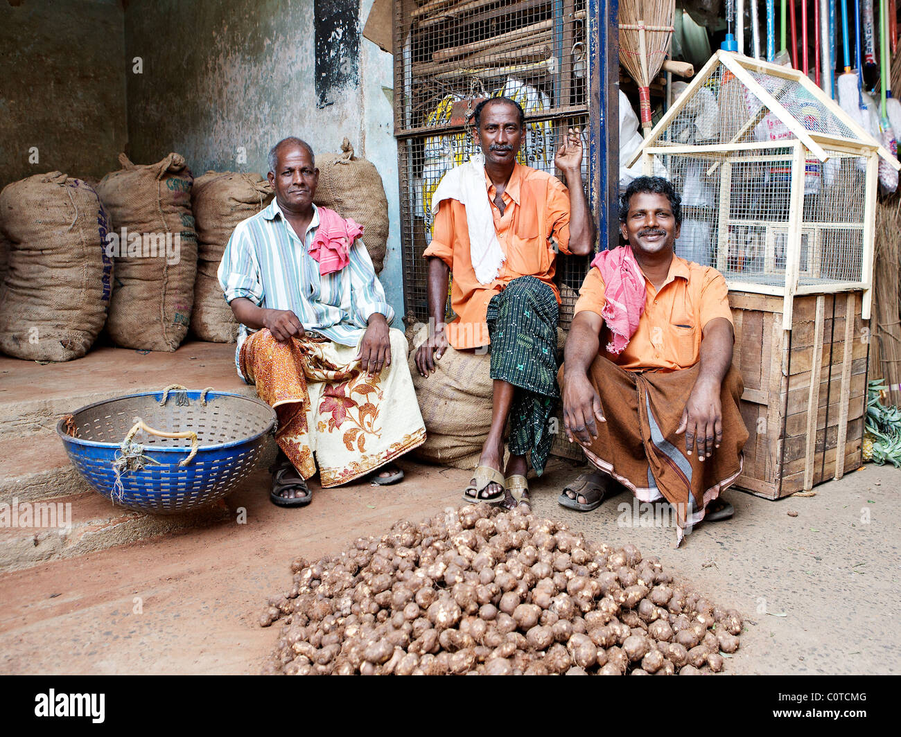 Fort Cochin market, Kerala, India; artichoke sellers - Stock Image