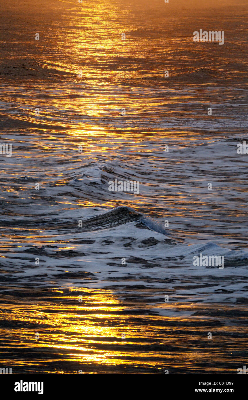 Winter sunlight on waves,Bournemouth - Stock Image