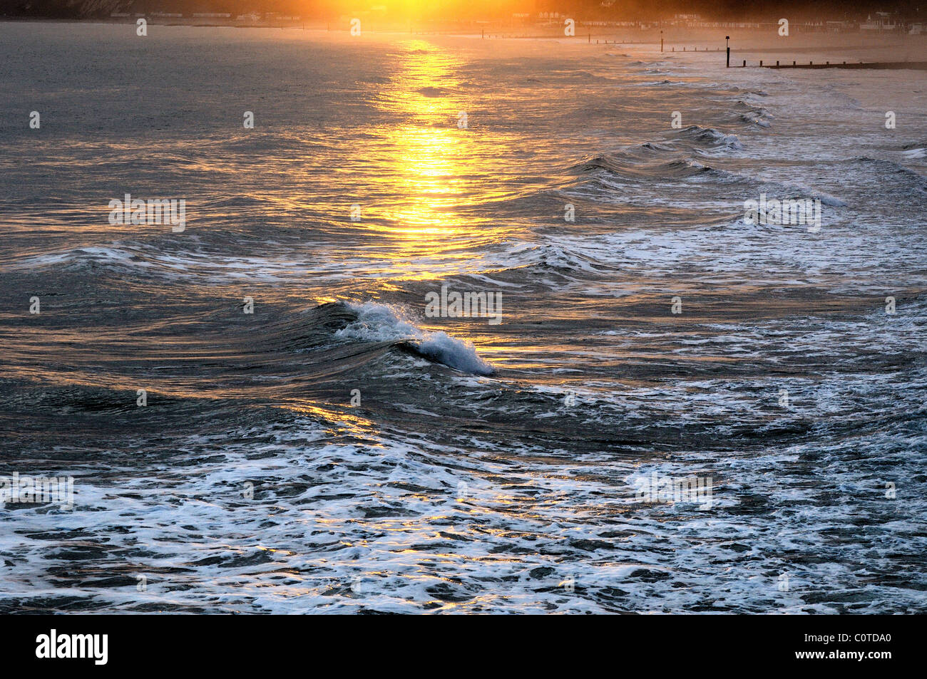 Winter sunlight on waves,Bournemouth Dorset England UK - Stock Image