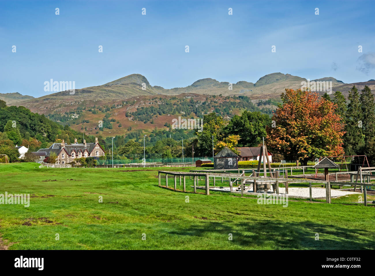 Playing field in Killin in Tayside Scotland with the Tarmachan Ridge behind - Stock Image
