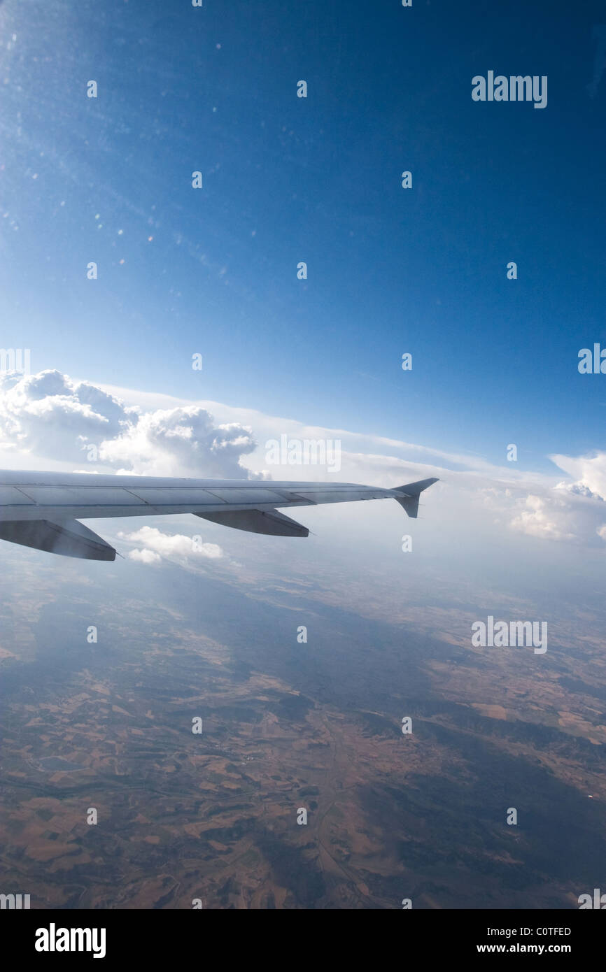 airplane wing aircraft aluminum flying sky in flight on Mallorca - Stock Image