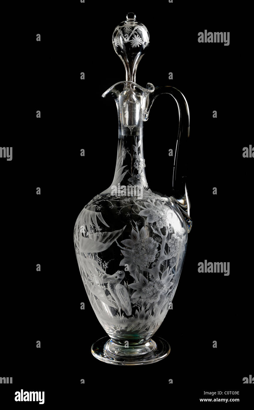 An English oinochoe shaped wine decanter finely engraved with motifs in the aesthetic taste, late Victorian - Stock Image