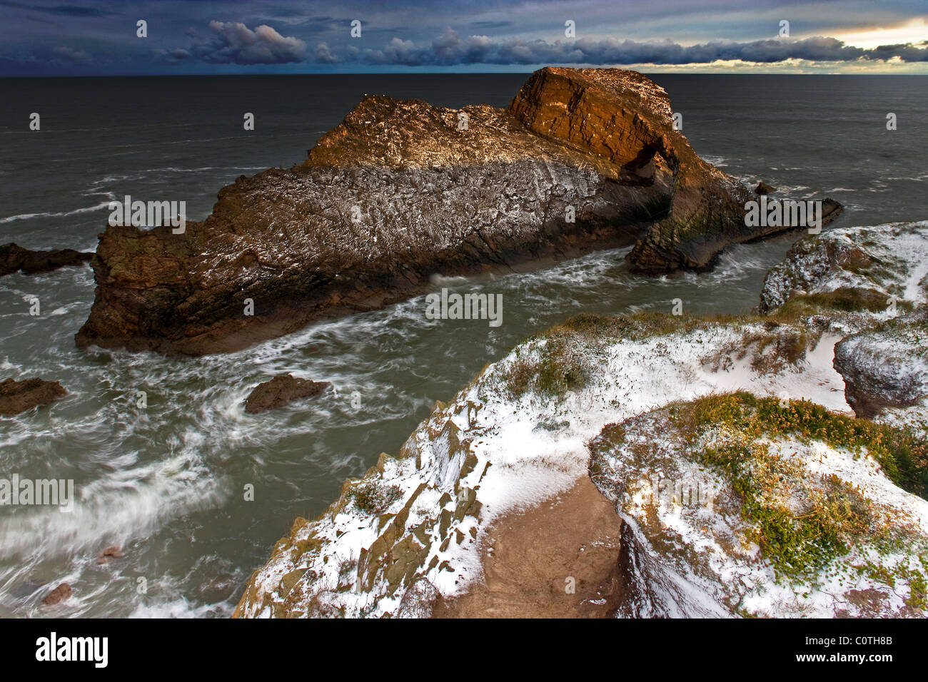 A view of The Bow Fiddle rock in winter near Portknockie, Moray, Scotland - Stock Image