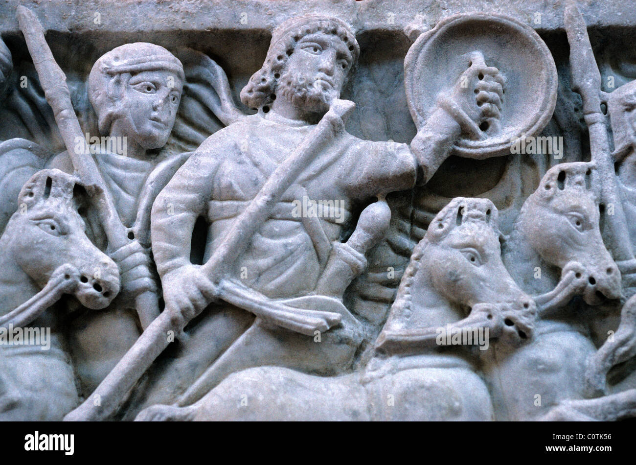 Bas Relief or Stone Carving of Roman Soldiers, Horsemen or Cavalry in Battle Scene, Arles Archaeological Museum, - Stock Image
