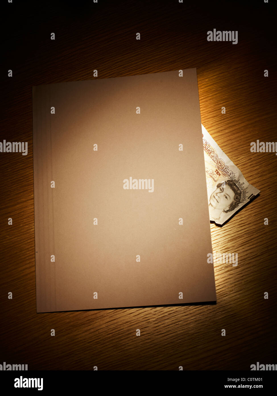 folder with a ten pound note - Stock Image