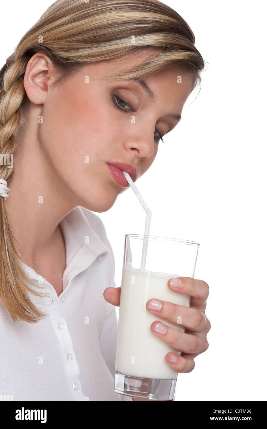 Woman drinking milk on white background - Stock Image
