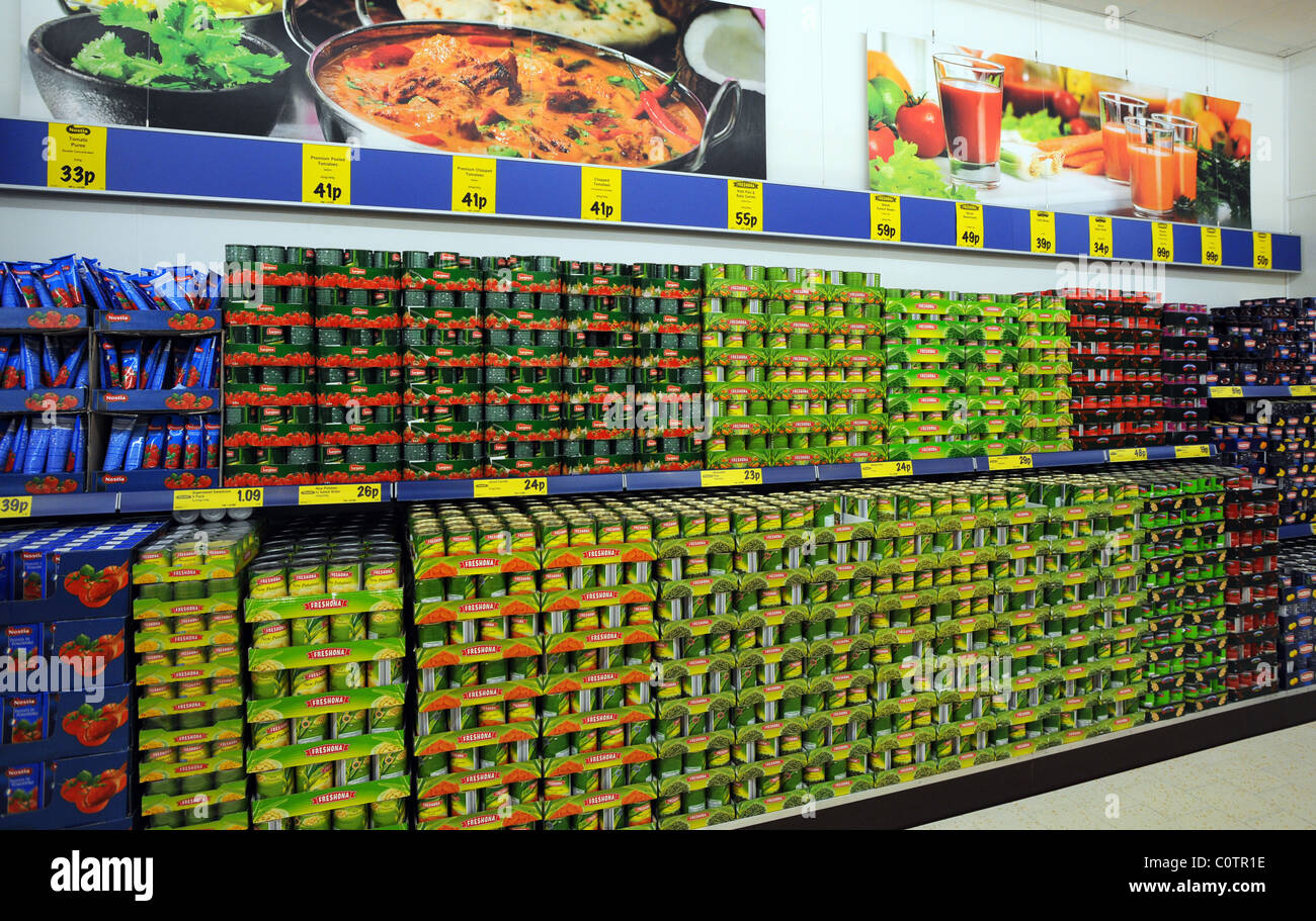 Lidl discount supermarket in Newhaven shelves packed full of tins of vegetables - Stock Image