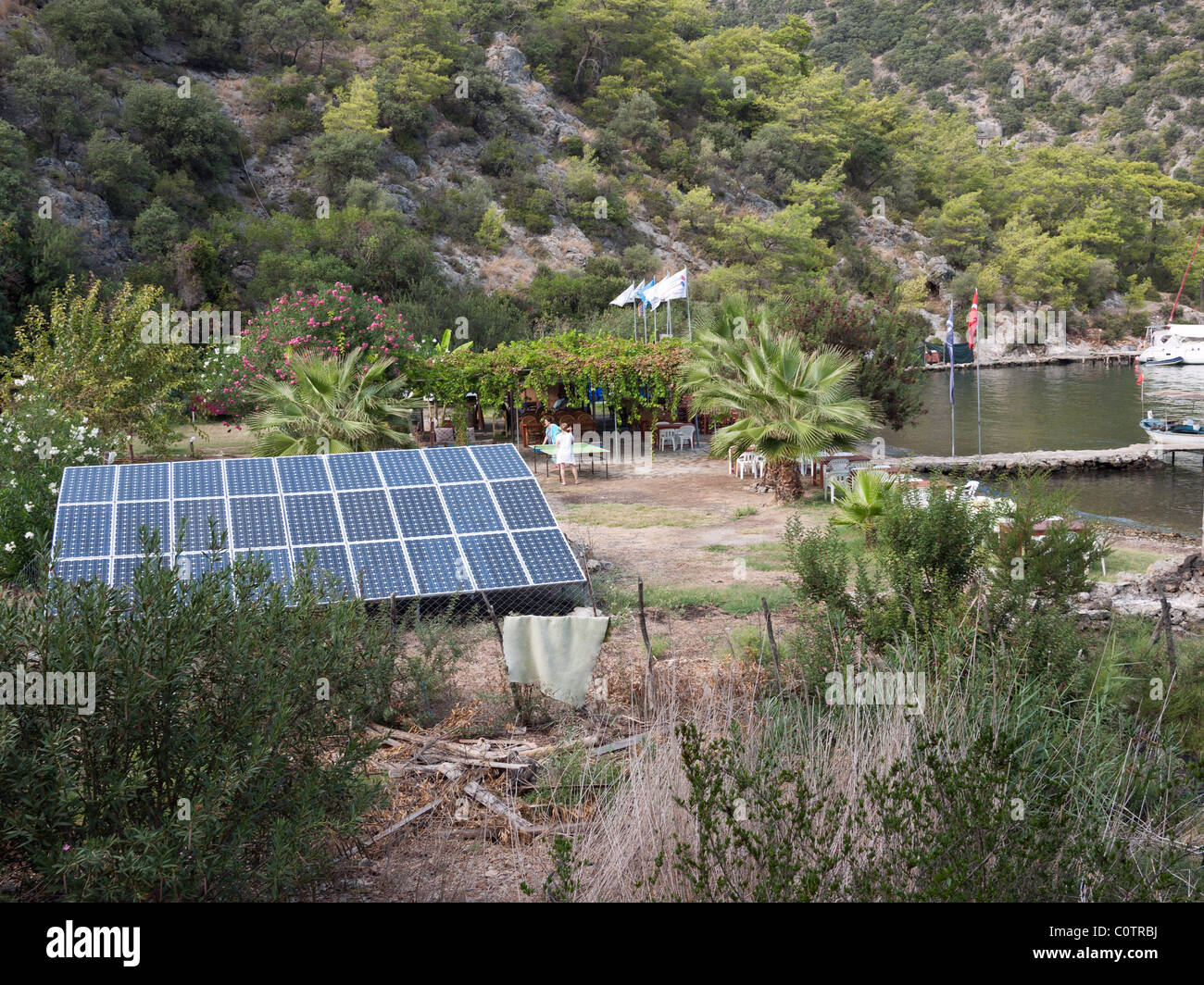 Solar panels to generate electricity for a remote beach restaurant in Tomb bay on the Lycian coast Turkey - Stock Image