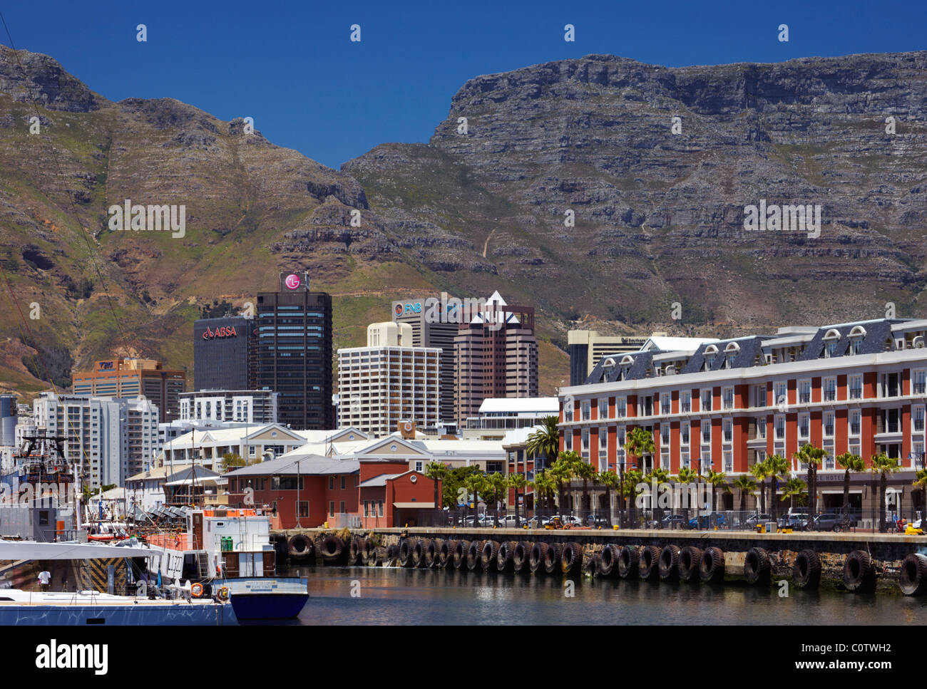 High-rise buidings viewed from the V&A Waterfront with Table Mountain beyond. Cape Town. Western Cape, South - Stock Image