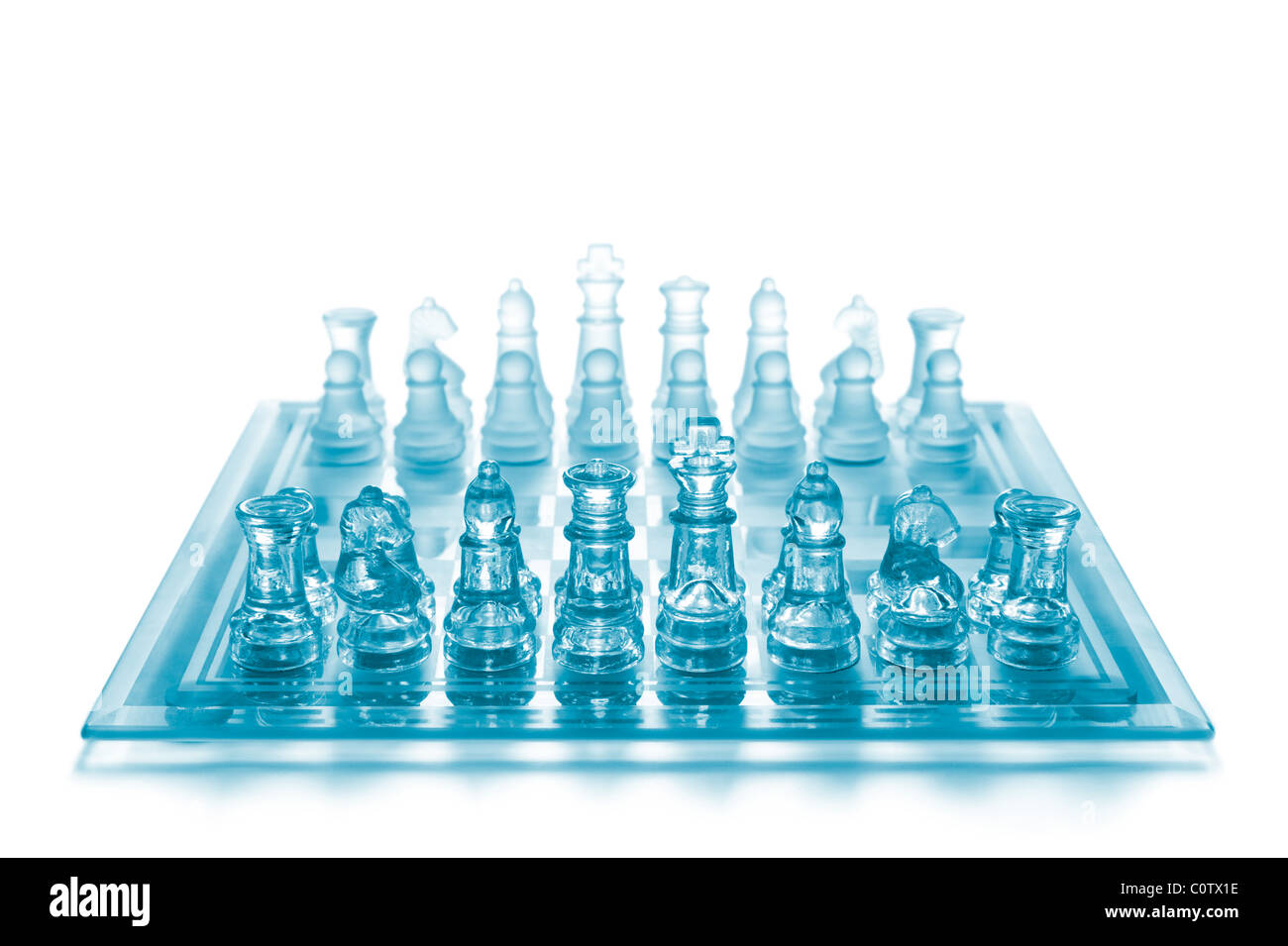 Glass chess on chess board - Stock Image