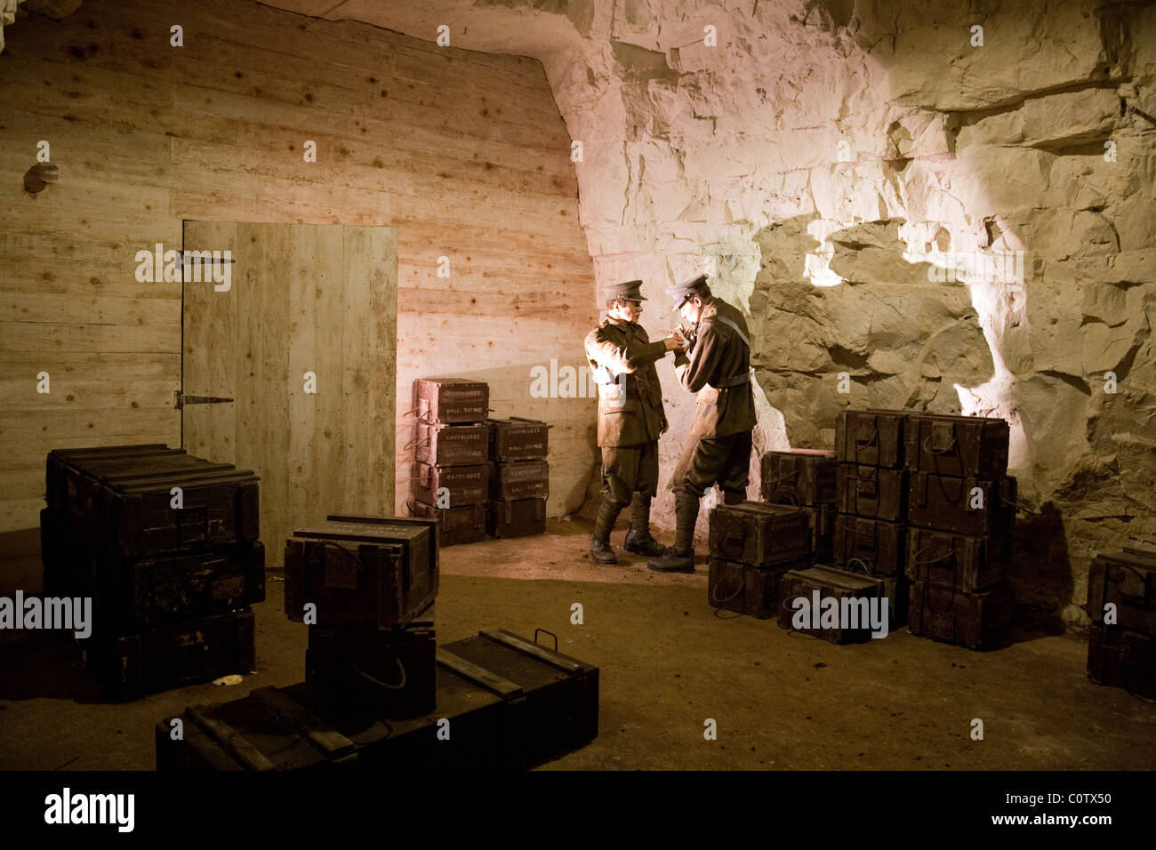 Recreation of a WW2 scene with soldiers, Chislehurst Caves, Chislehurst, Kent, UK - Stock Image