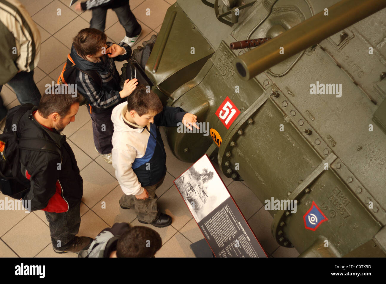 London Imperial War Museum visitors read the information about a WW2 Sherman tank - Stock Image