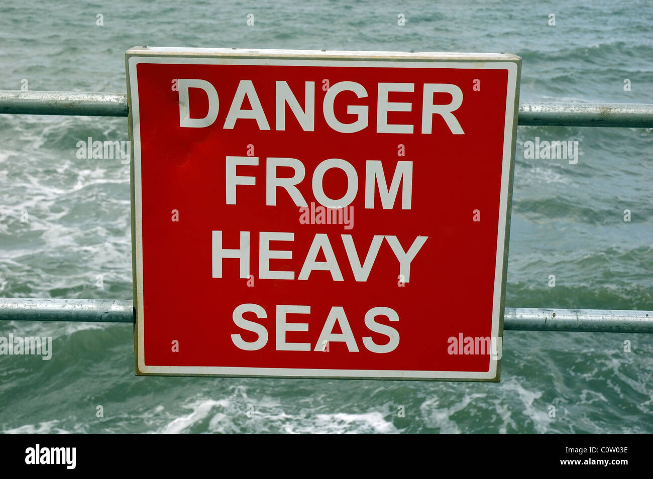 Danger From Heavy Seas sign, Scarborough, North Yorkshire, England, UK - Stock Image