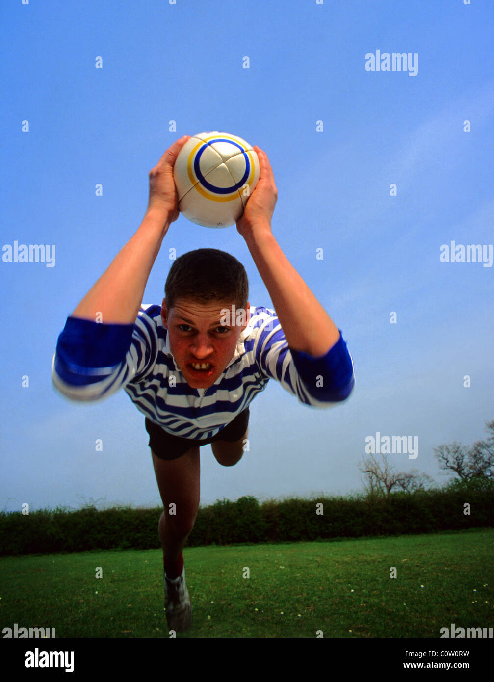 rugby player diving towards try-line to score try uk - Stock Image