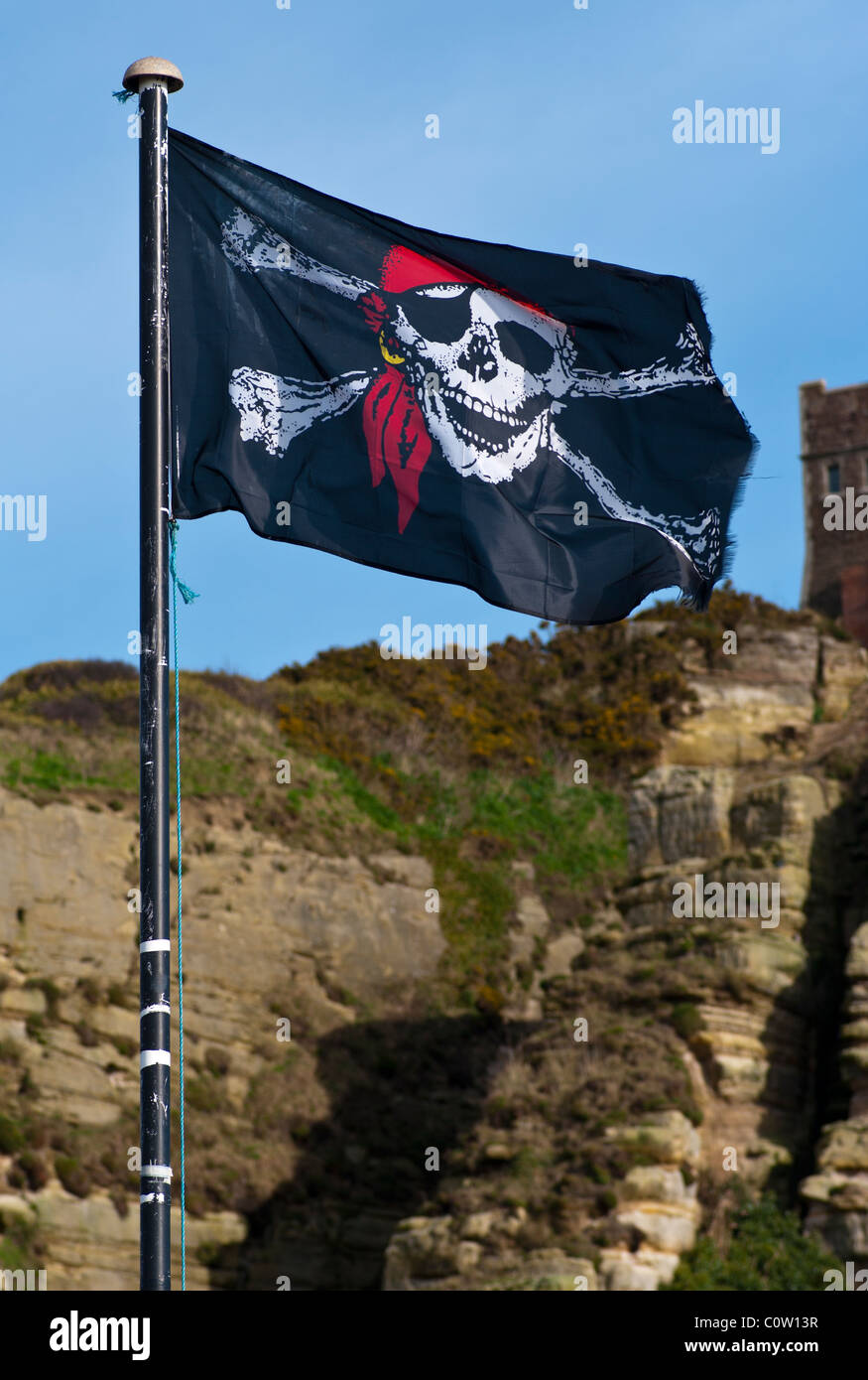 Jolly Roger Skull and Crossbones Flag - Stock Image