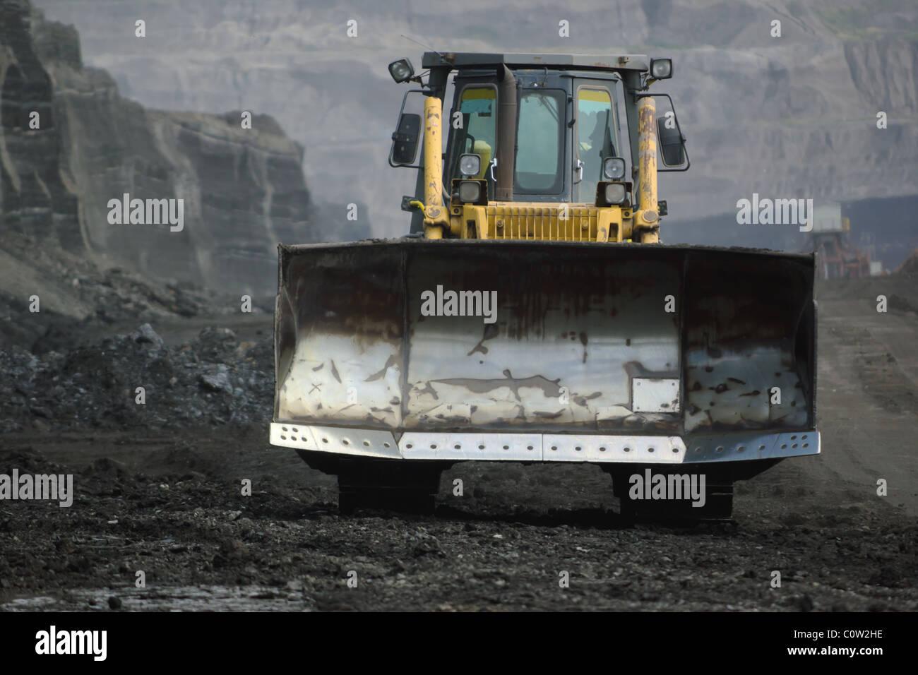 bulldozer in coal mine - Stock Image
