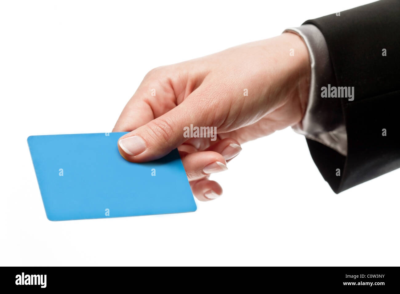 Credit card in a male hand isolated on white Stock Photo
