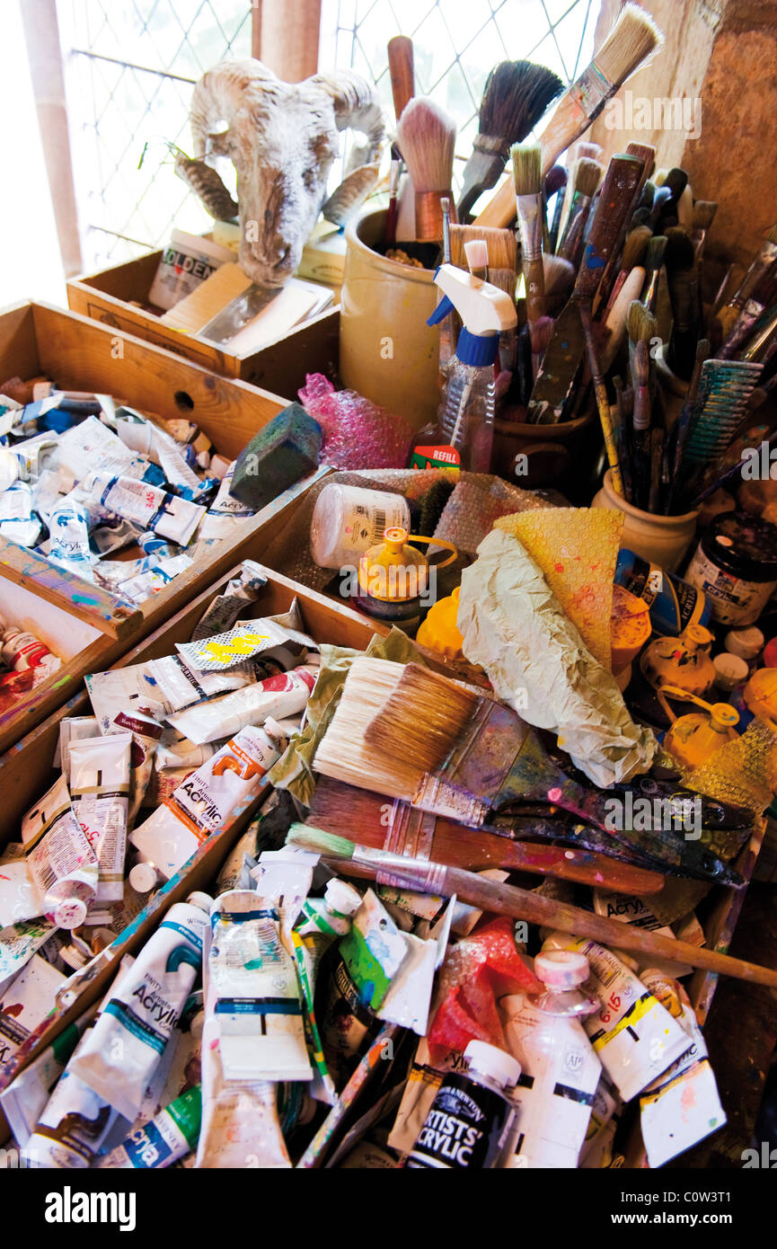 Selection of artists paints and brushes in studio - Stock Image